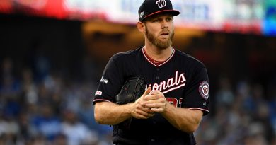 Strasburg lives up to hype, leads Nats to title