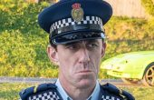Mike Minogue plays a cop tracking the 'Wellington Paranormal'